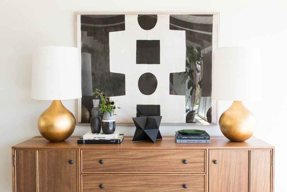 Mid-Century Home with Modern Artwork and Natural Wood Cabinet