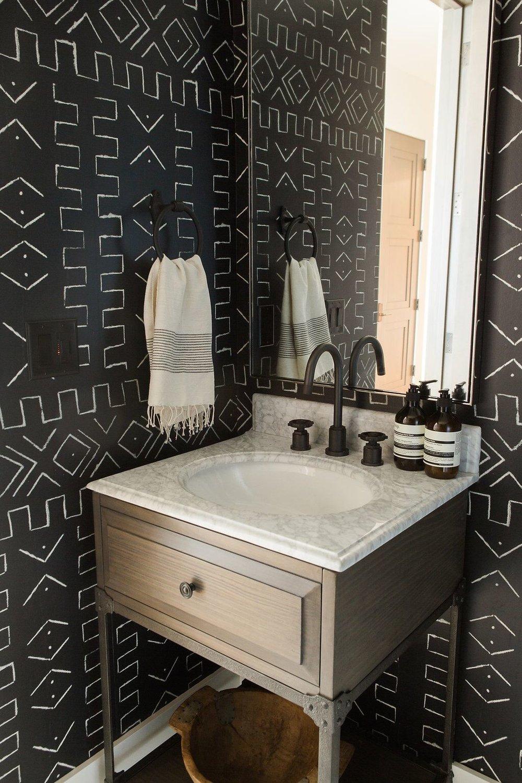 Dramatic tribal bathroom wallpaper