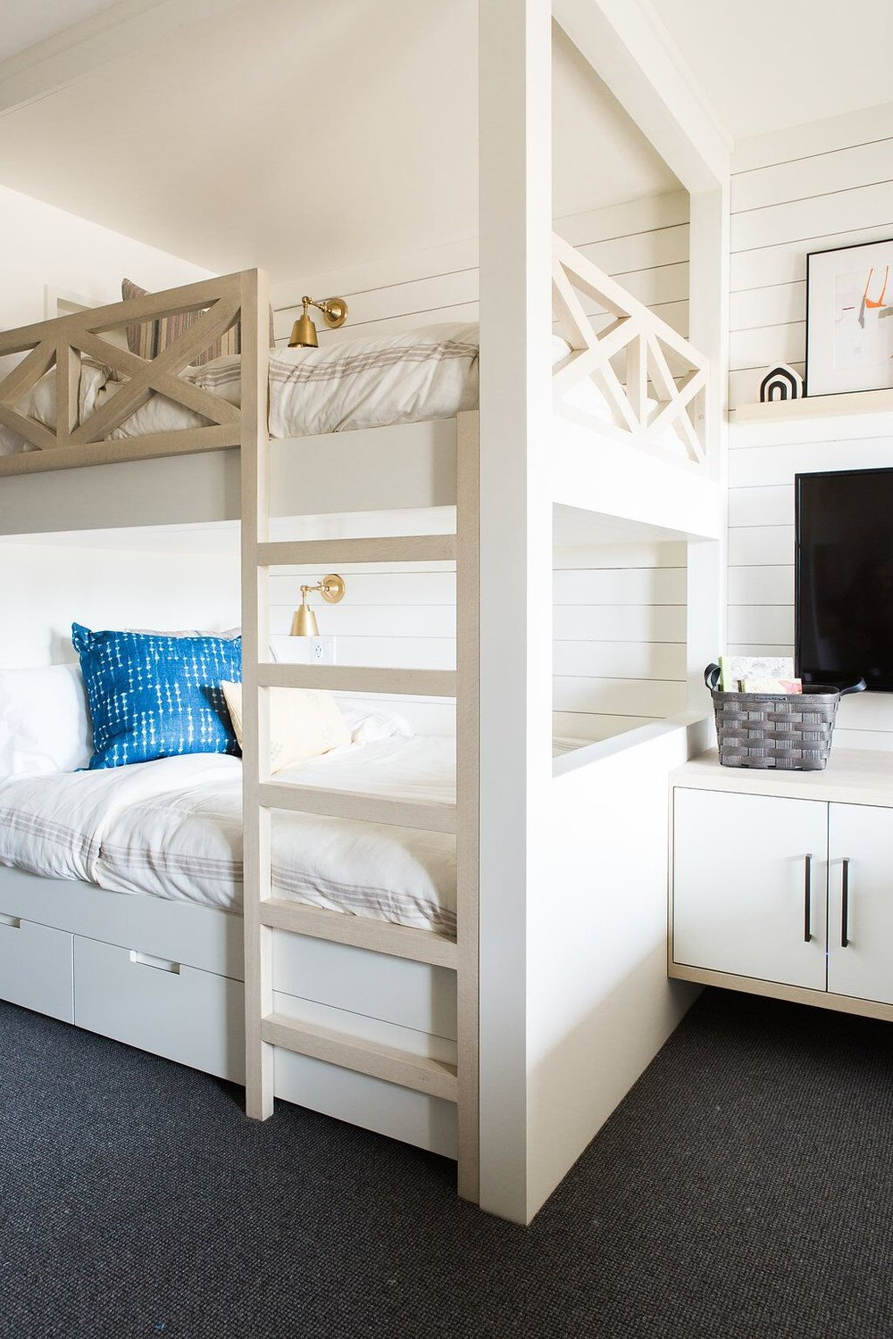 Kids bedroom with built-in bunk beds with shiplap walls