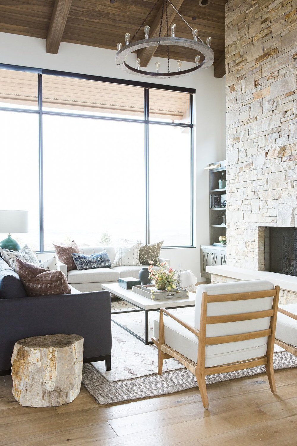 White chair and grey couch in modern living room