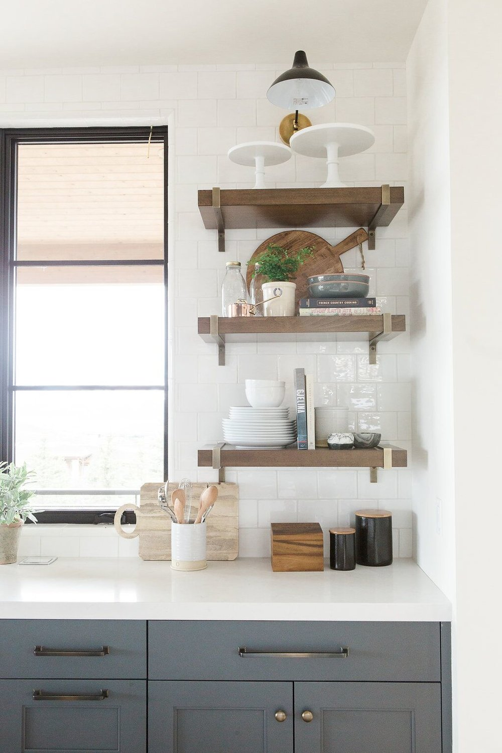 Built in wooden shelves along modern kitchen wall