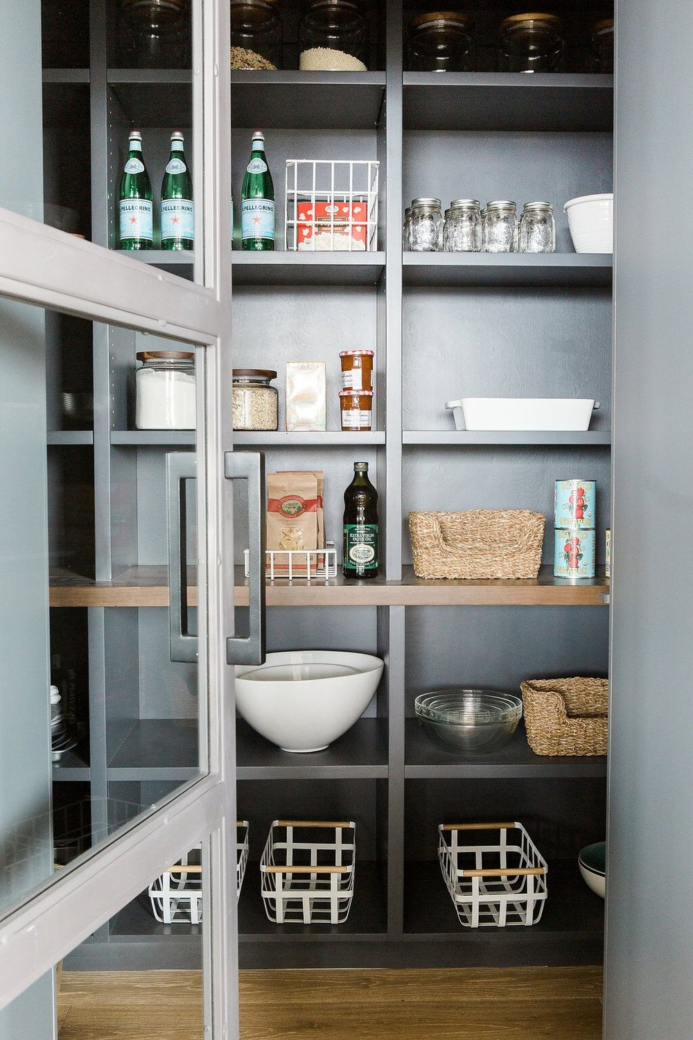 Grey modern pantry with bowls and food