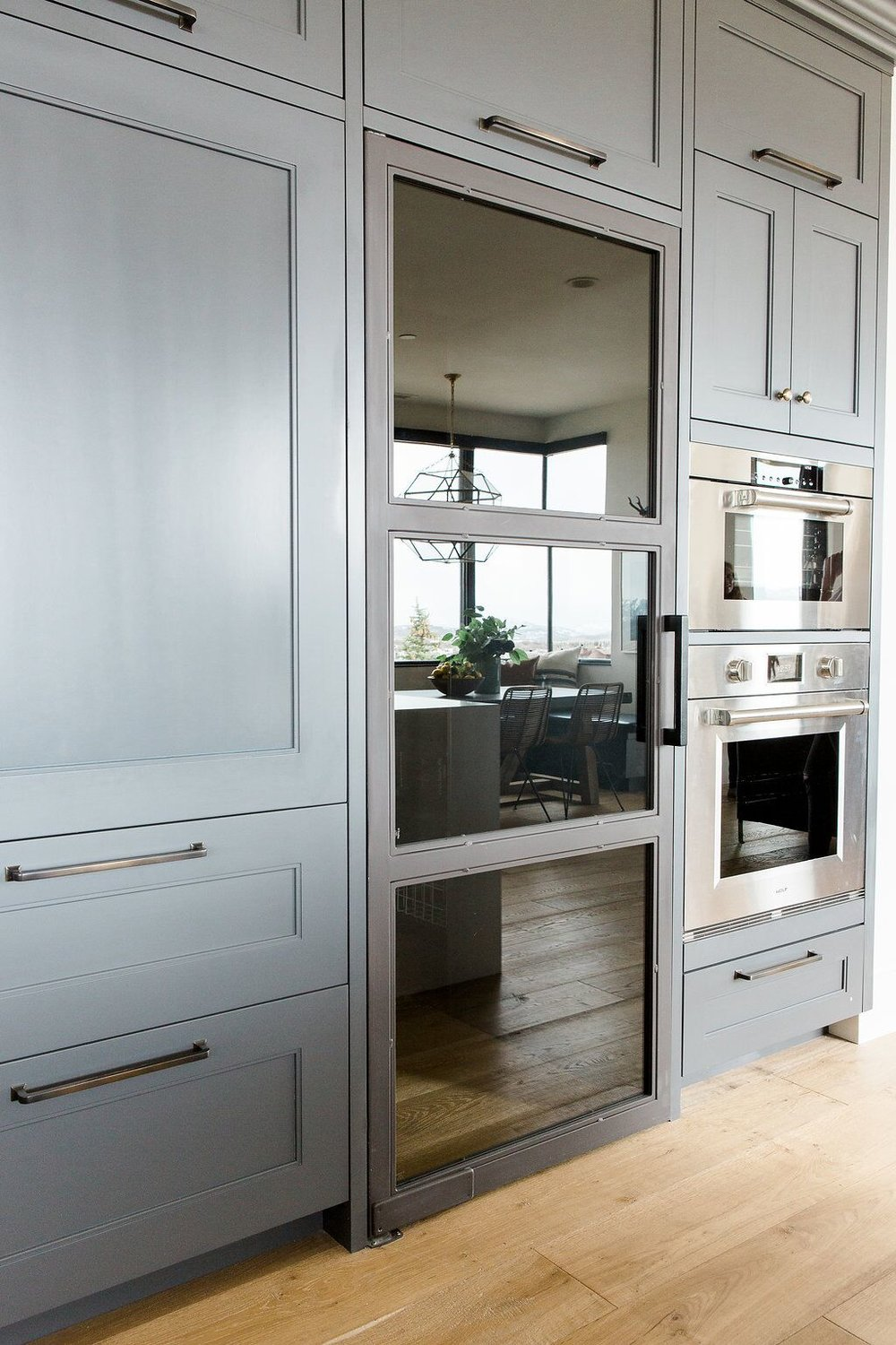 Large glass door and double oven in modern kitchen