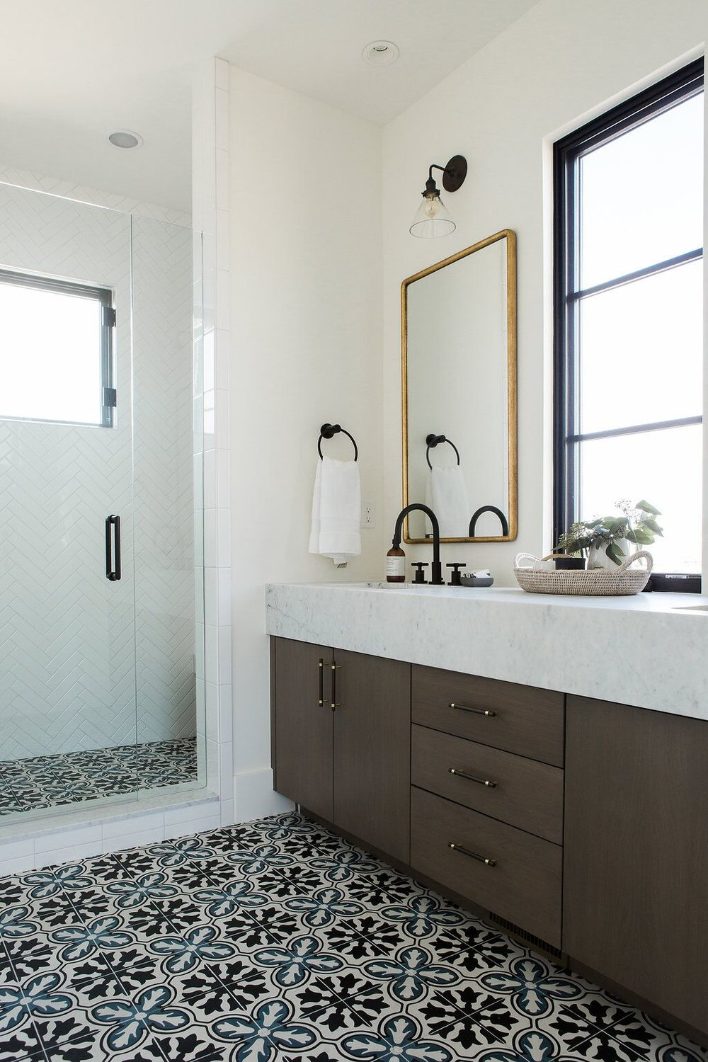 Master bathroom with black and white tiled floor