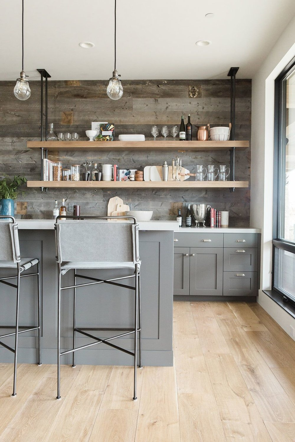 Tall stools underneath grey bar