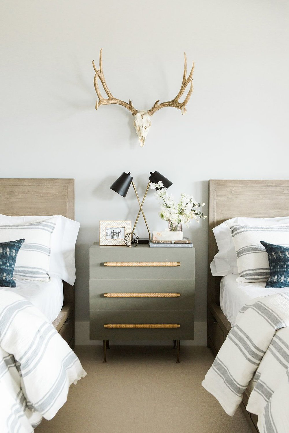 olive green modern nightstand between twin beds