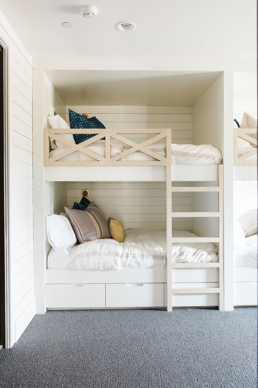 Twin bunk beds in kids white kids room