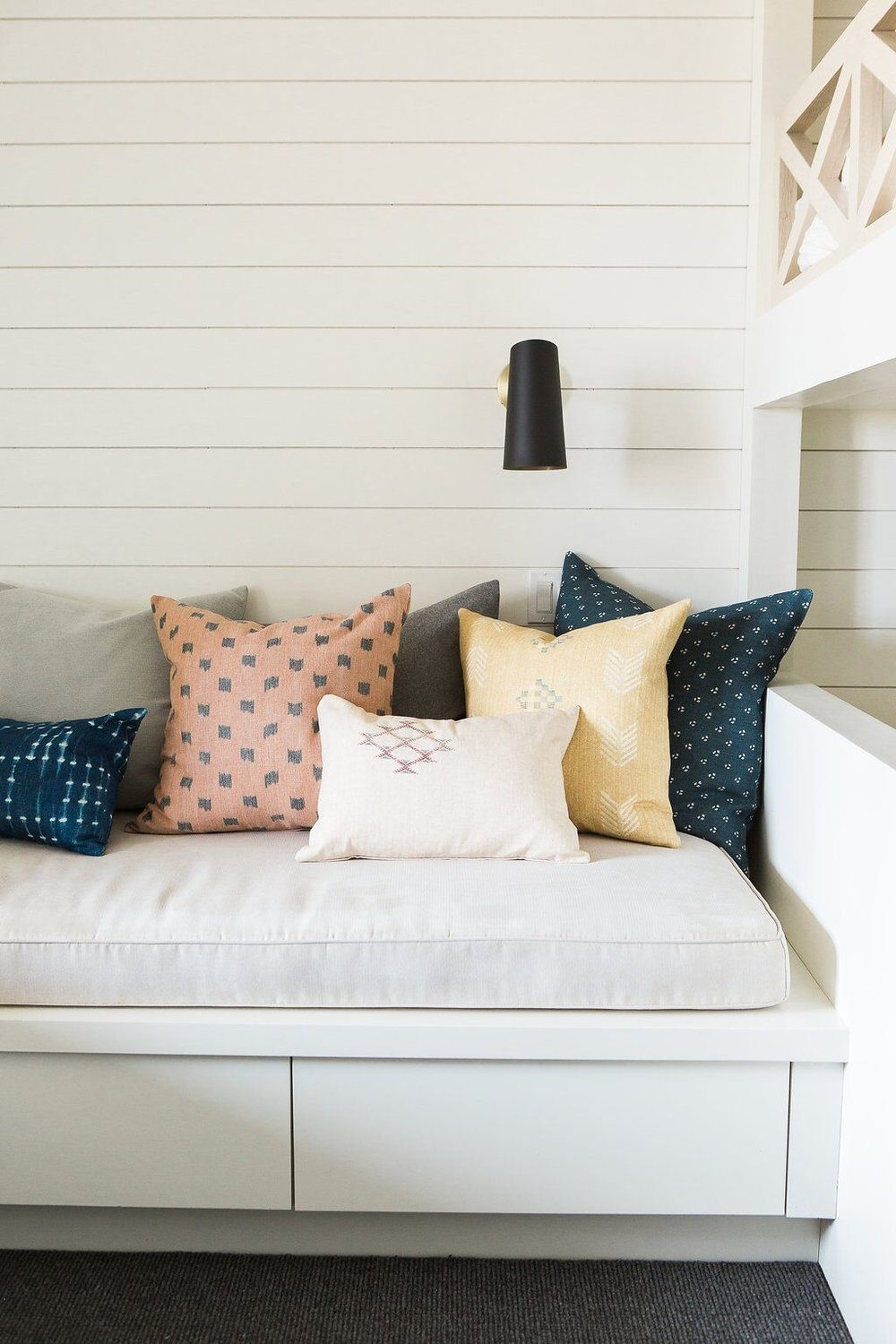 Built in day bed with shiplap walls
