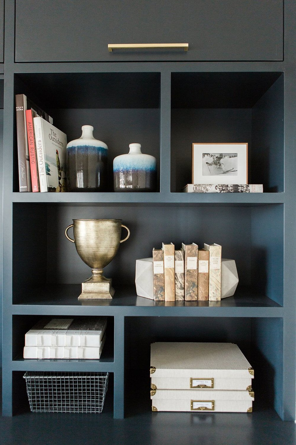 Built in blue shelf with books in home office