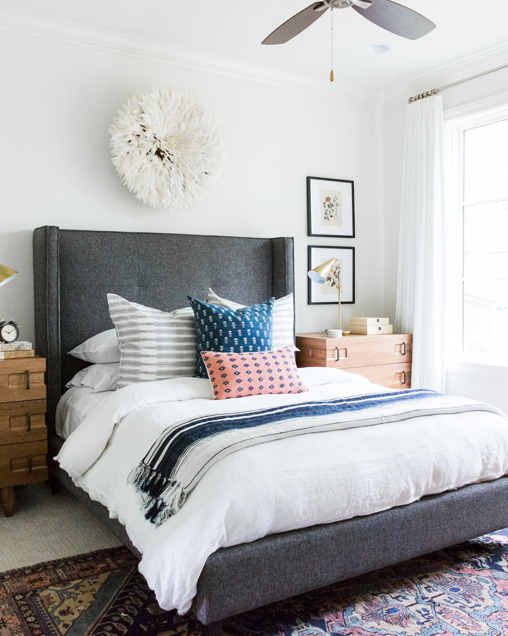 Coastal Bohemian Guest Bedroom with Vintage Rug and Botanical Prints