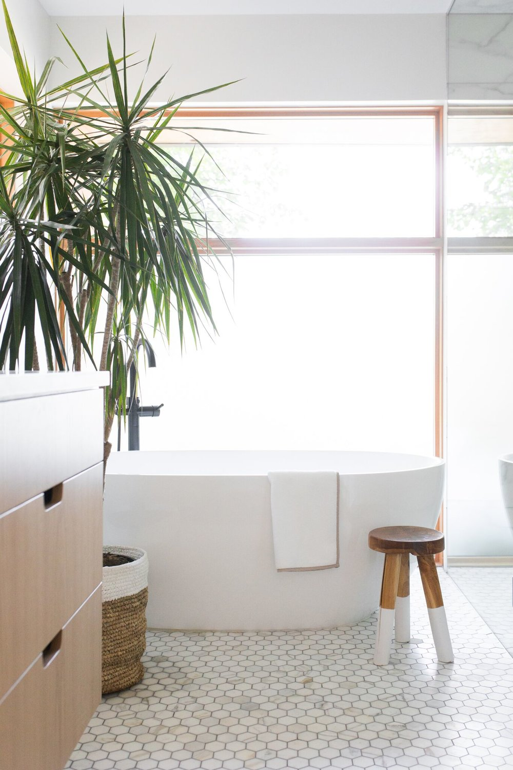 All natural, white bathroom with modern accents