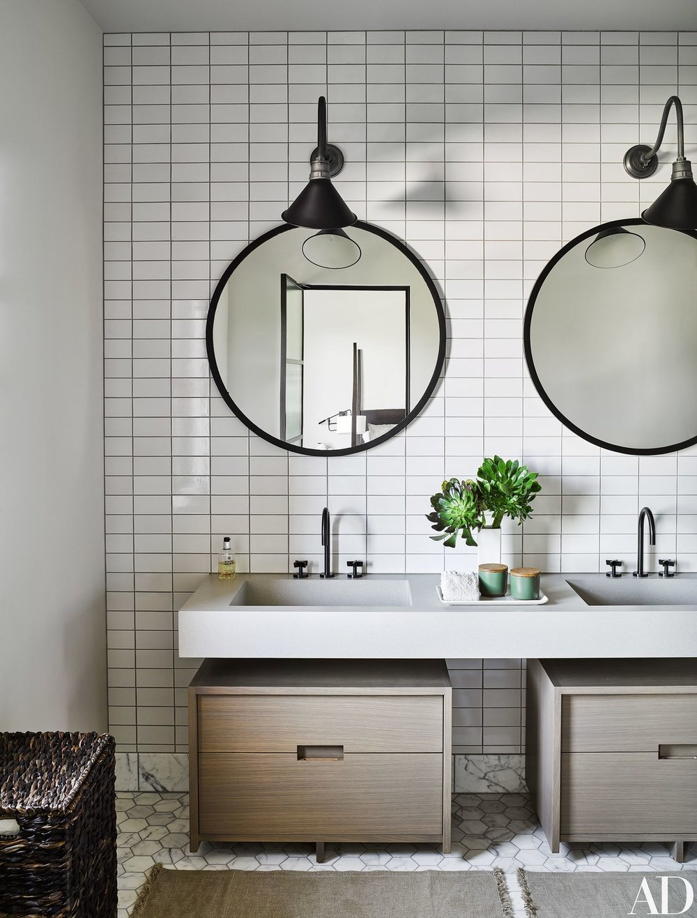 traditional bathroom vanities with double sink and circle mirror | Our Guide to Patterned Tile