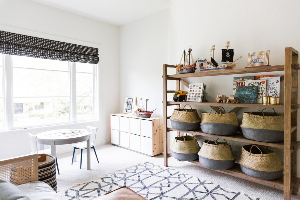 17Shelving+and+Baskets+for+Toy+Storage+in+Coastal+Bohemian+Kids'+Playroom.jpg
