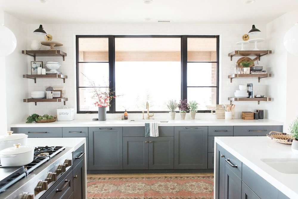 23Modern+kitchen+with+open+shelves,+vintage+rug,+and+blue+cabinets+with+white+countertops.jpg