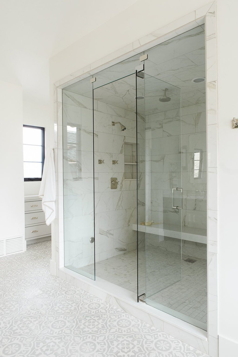 39Master+bathroom+with+concrete+tile,+free+standing+tub,+and+walk+in+shower.jpg