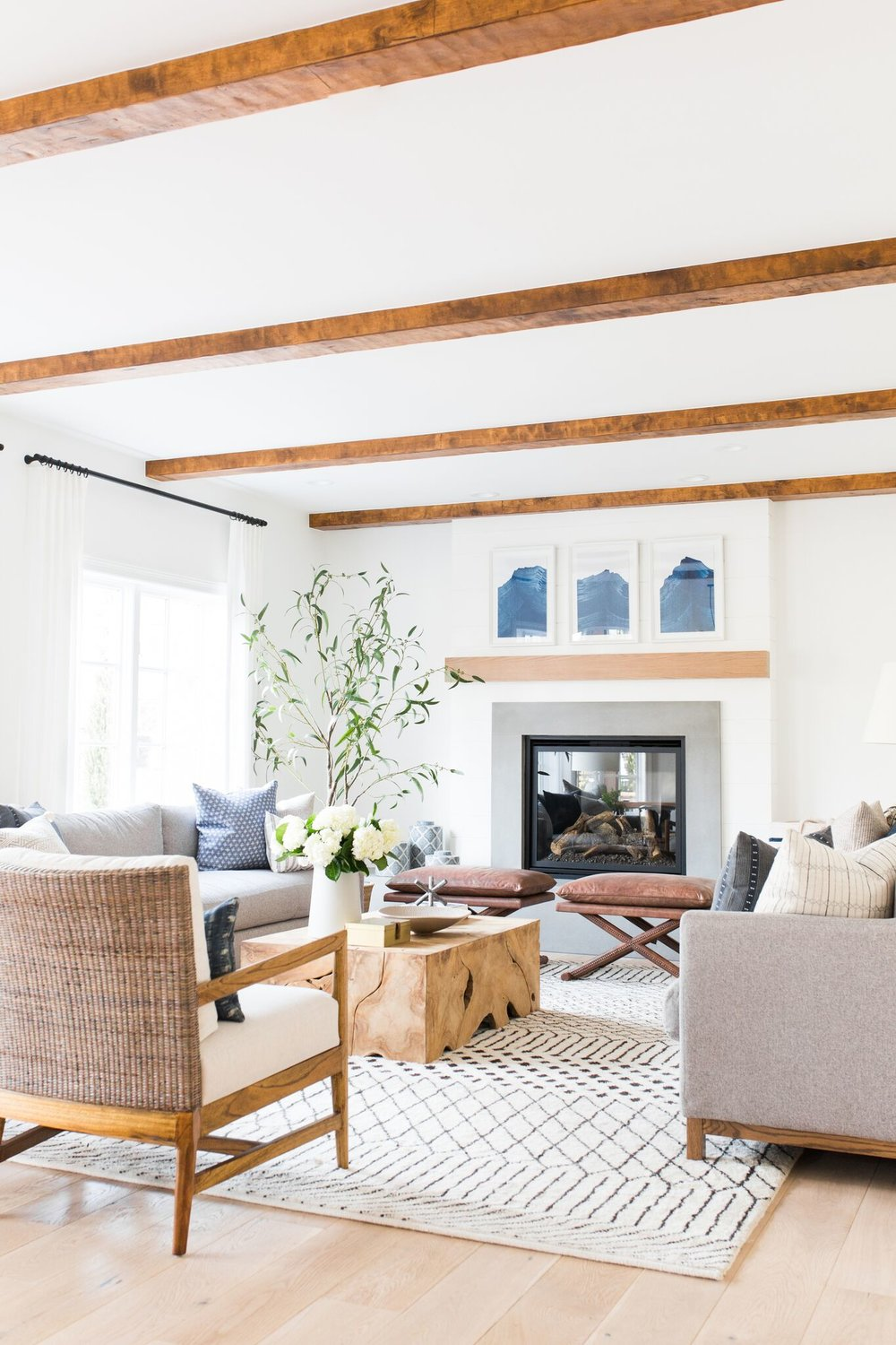 Shop the Look:  Budapest Rug in Natural ,  Clayton Long Sofa ,  Tory Coffee Table ,  Winslow Stools ,  Blue Jars ,  Newport Cross Pillow ,  Moody Mountain Artwork