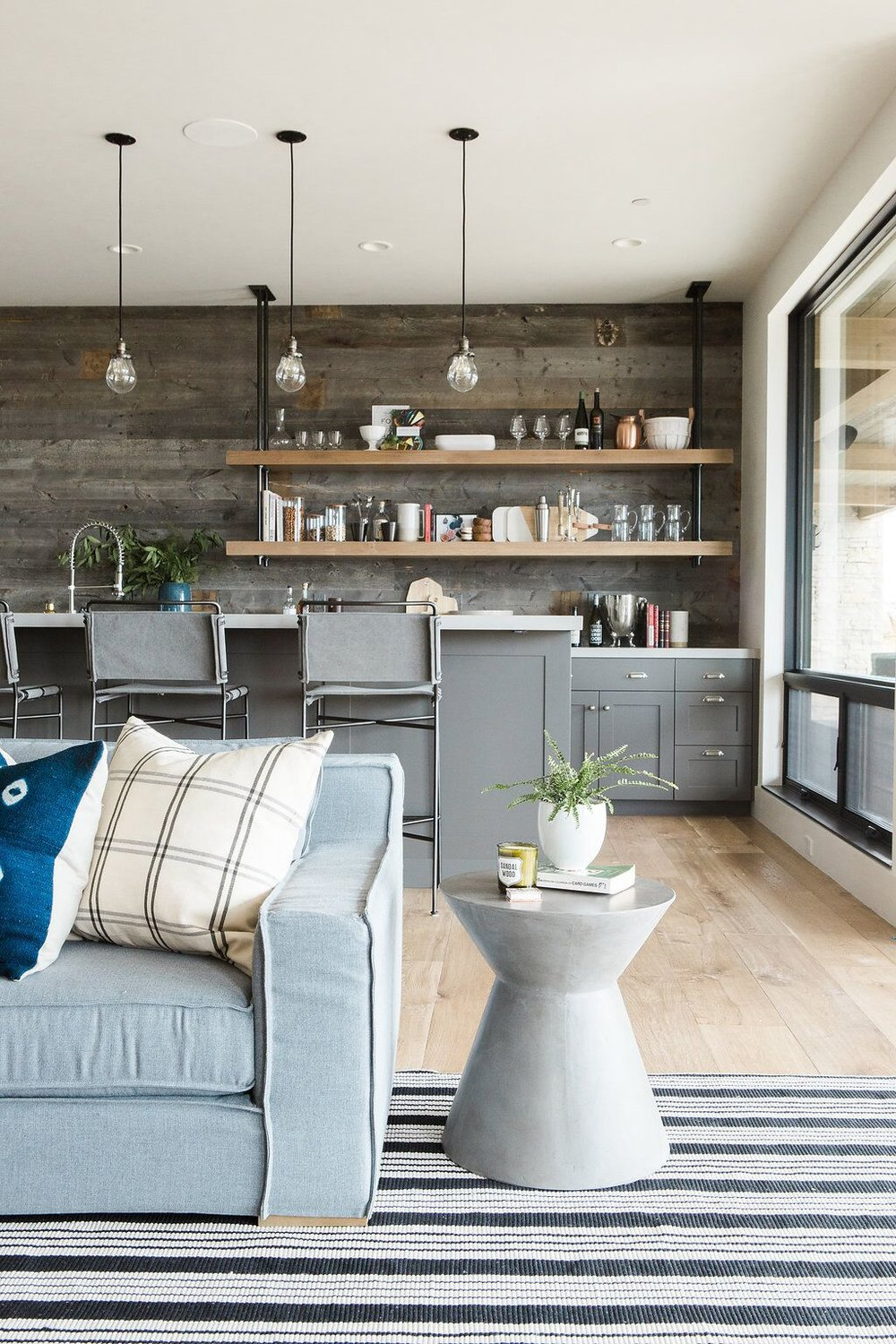 Industrial+designed+wet+bar+with+reclaimed+wood+and+pipe+shelving.jpg
