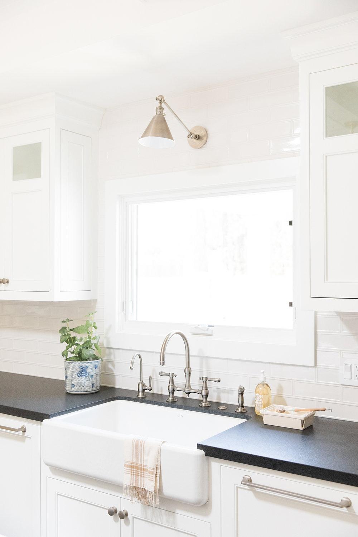 Coastal textured kitchen with pendant lighting and blue island.-Studio McGee.jpg
