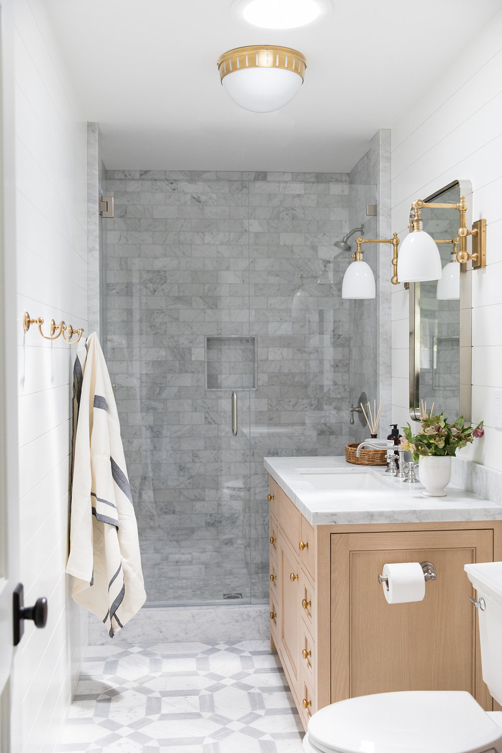 Bathroom with marbled tile, countertops, marble showe, brass & marble bathroom, coastal bathroom | Studio McGee Blog