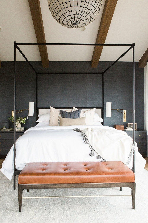 Master+bedroom+in+blue+grasscloth+wallpaper,+statement+chandelier,+and+leather+bench.jpg