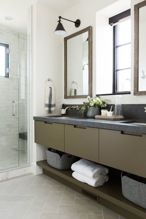 33Guest+bathroom+with+olive+green+cabinets+and+dark+countertops+and+limestone+herringbone+floors.jpg