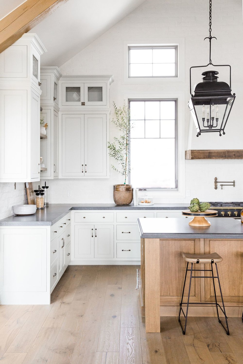 Refined,+rustic+kitchen+with+exposed+wooden+beams,+hanging+lanterns,+painted+white+brick,+oven+range+in+mountain+home+-+Studio+McGee+Design-3.jpg