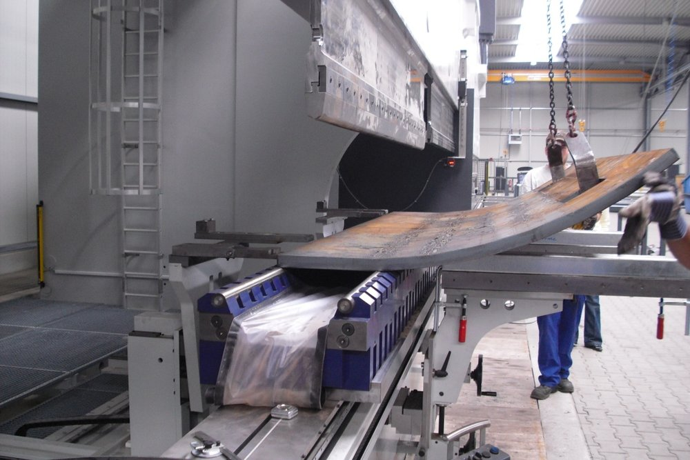 Heavy or large work piece bending requires additional support from other operators or lifting equipment at the front of the press brake.