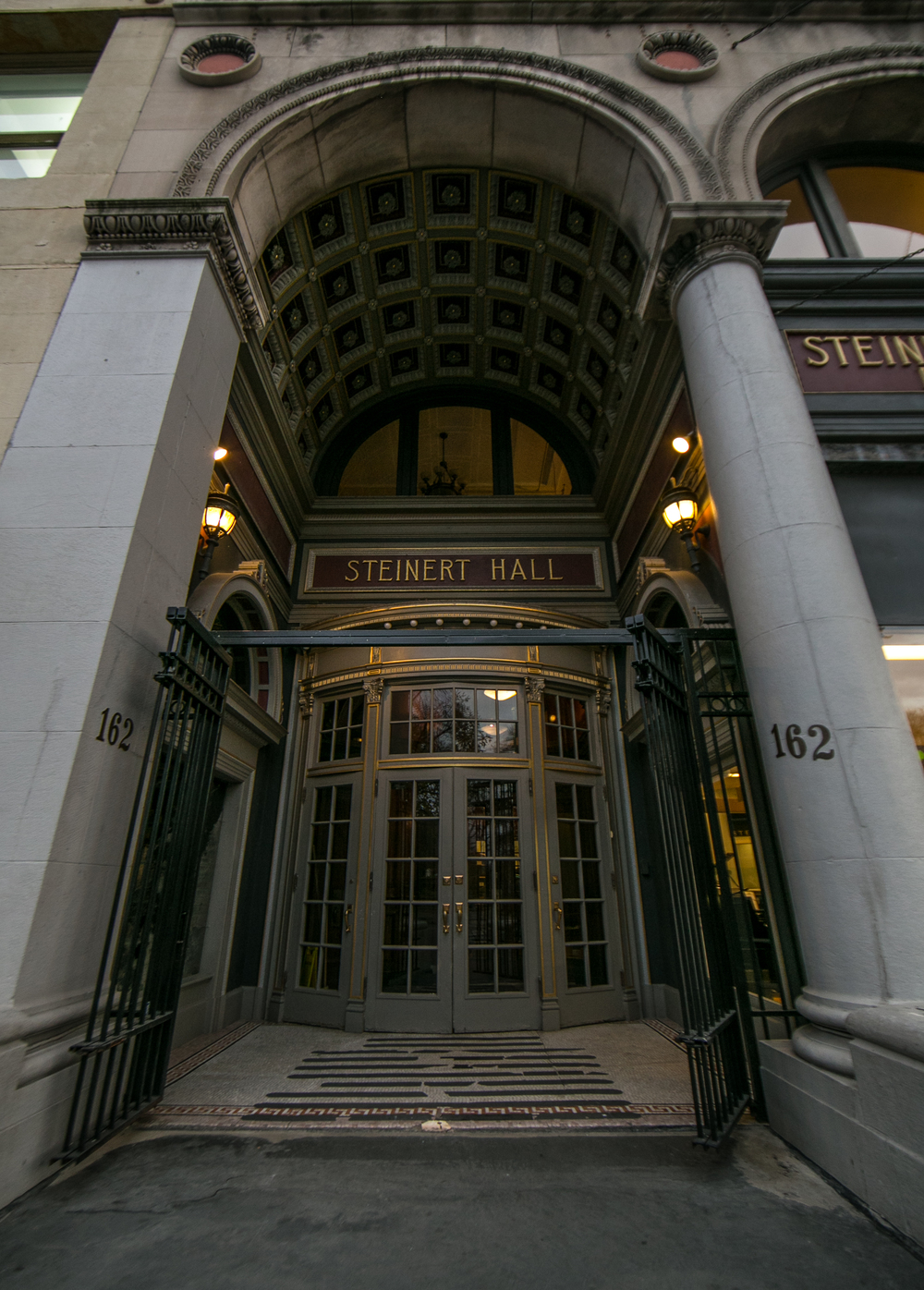 November 10, 2015: 162 Boylston Street, Boston, Mass. – The entranceway to M. Steinert and Sons piano storefront was designed by architects, Winslow and Wetherell during the construction of the building in 1896. The doorway is original to the six-story limestone and brick Beaux Arts-style façade, and once served as the main entrance to Steinert concert hall. ©Mike Schwarz