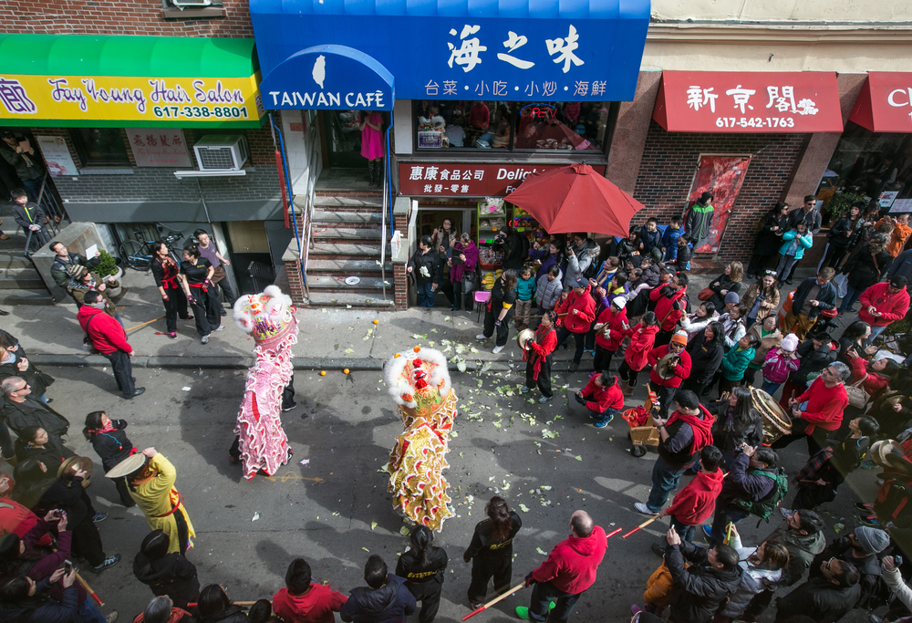 February 21, 2016: A Lion Dance is performed in honor of the Chinese New Year outside the Taiwan Café at 34 Oxford St., Boston, Mass. The celebration is organized by the Boston Chinese Freemasons and features lion troupes from all over the Boston area. Members from rival clubs compete to put on the best performance for the crowd using a series of fast-paced traditional dances, long strings of firecrackers, and live musical accompaniment.   ©  Mike Schwarz