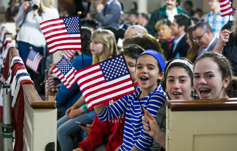 February 29, 2016 - Julianne Sheehan (left), Ilkin Gumus (middle), and Grace Akkara (right) chant in support of former Secretary of State Hillary Clinton during a rally in Boston's Old South Meeting House on the final morning before Super Tuesday. The March 1 vote will consist of more than 800 delegates, or one third of the delegates needed to claim the democratic nomination in the U.S. presidential election. ©Mike Schwarz