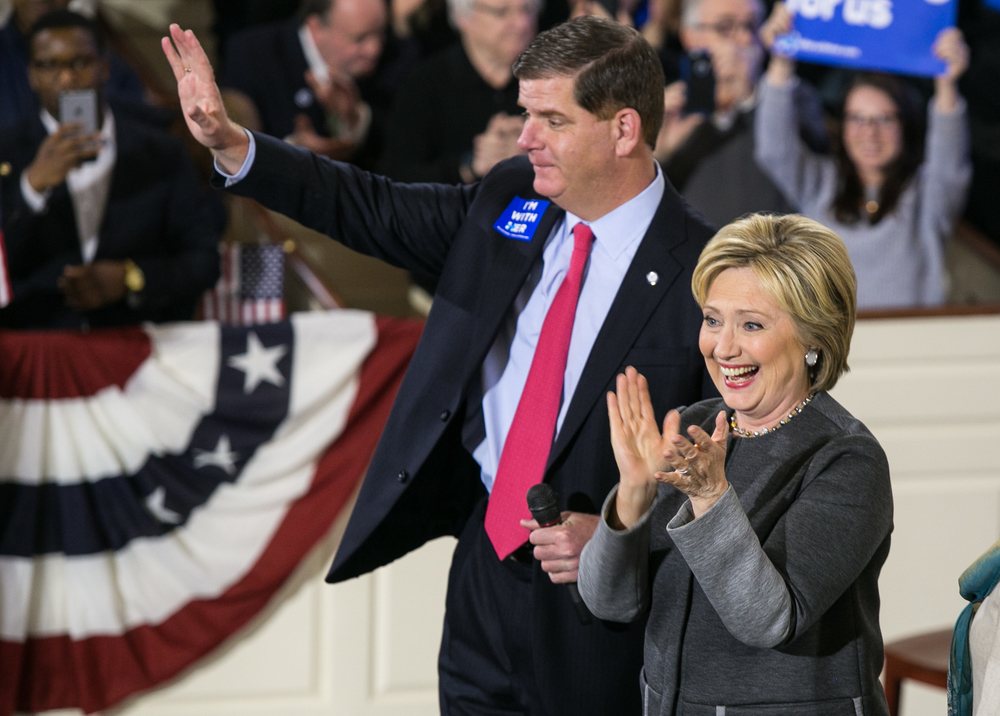 "February 29, 2016 - Former Secretary of State Hillary Clinton and Boston Mayor Marty Walsh greet supporters as they emerge on to the stage during a rally at the Old South Meeting House in Boston, Mass. Hillary boasted several prominent endorsements including Mayor Walsh and Massachusetts Senator Ed Markey. ""And it's my honor to introduce to you the woman who is not only going to win Massachusetts tomorrow, but be the next president of the United States America,"" Mayor Walsh said during his introduction. ©Mike Schwarz"