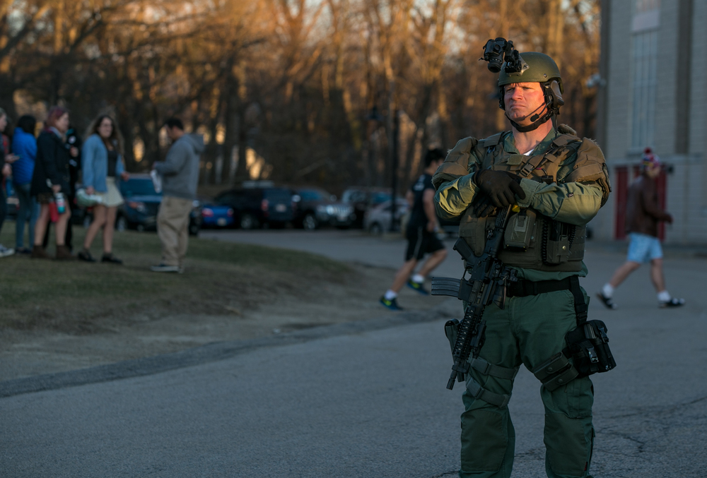 February 29, 2016 - A member of the Boston METRO SWAT team stands guard outside of U.S. Senator Sanders D-Vt. rally in Milton, Mass. on the eve of Super Tuesday. Other security measures included bomb sniffing dogs, pat-downs, and metal detectors. A line of attendees snaked through the parking lot as it took nearly four hours to get all 3330 potential voters inside the gymnasium. ©Mike Schwarz