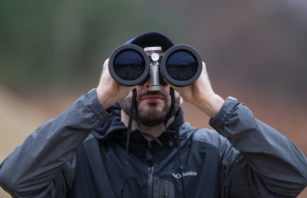 "April 2, 2016 – Cory Absi, an alumni of the Boston University Rocket Propulsion Group, watches from the required distance of 120 yards moments before the ""hot fire"" test run of the newly developed Lotus engine in Sudbury, Mass. Two of the Lotus engines will eventually be installed on the Starscraper, a 30-foot 1200-pound rocket, and launched from the Black Rock Desert in the summer of 2017. The Boston University team is in a tight race with the University of Southern California to be the first student designed and constructed rocket to reach space – or about 62 miles above the earth's surface.   ©  Mike Schwarz"