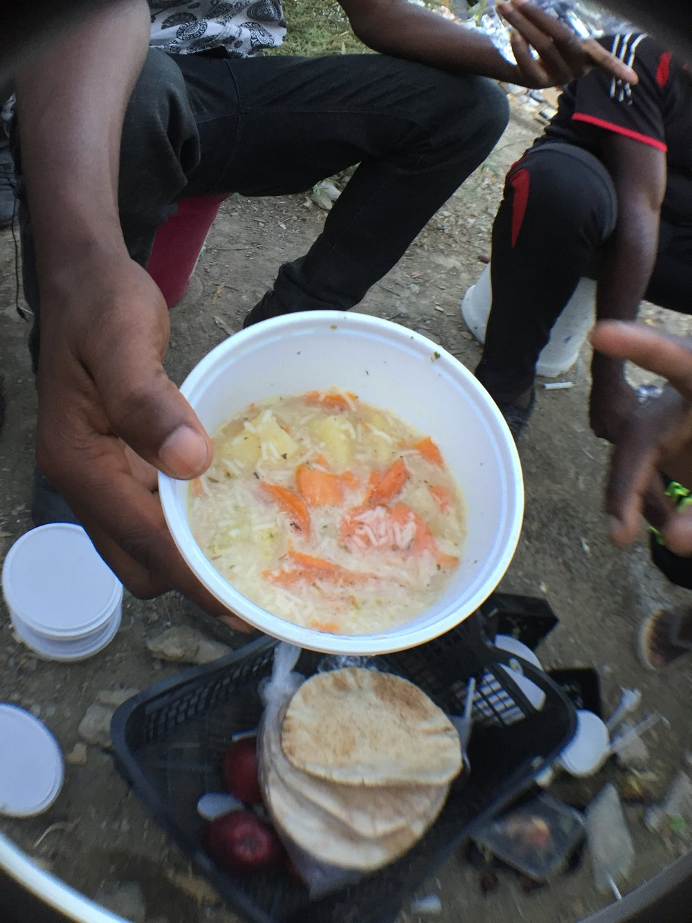 "Food with dirt and mud in it. ""They give us rabbit food,"" one Nigerian refugee said."