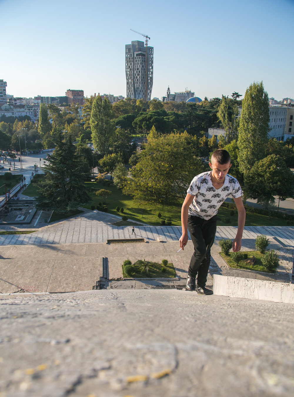 An Albanian boy climbs the Pyramid of Tirana. The city does not discourage climbers from hanging out on or atop the abandoned monument.