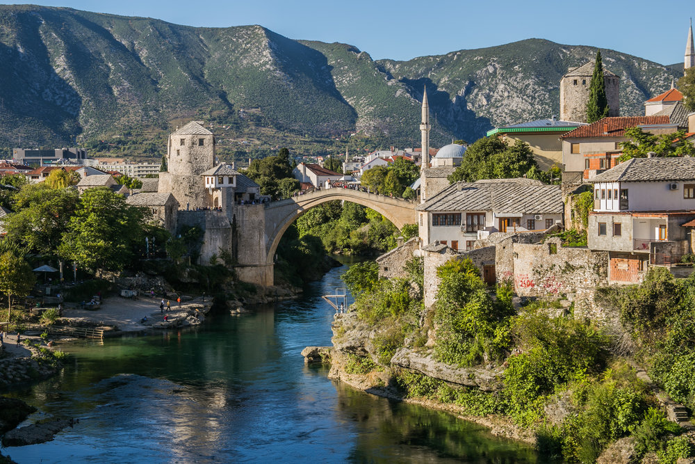 A view of the historic Old Bridge in Mostar, Bosnia. The bridge has become a major tourist attraction for the city, and even drew the Red Bull Diving Competition to host their events in Mostar. The bridge was partially destroyed during the Bosnian War, but after its reconstruction in 2004, has become a symbol of cultural importance for the people of Bosnia. It is over 70 feet high.
