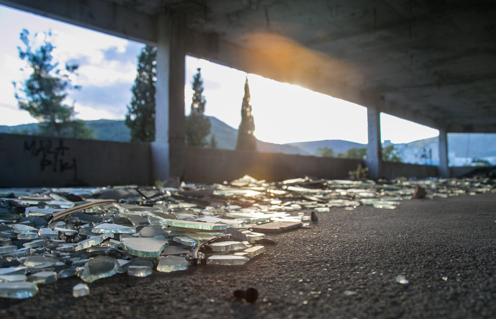 Shattered glass riddles the floor of an abandoned sniper tower left over from the Bosnian War in Mostar, Bosnia.