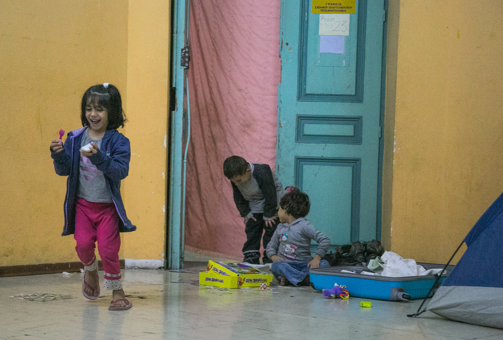 10/19/16 - Children play in the lobby of Jasmine School.