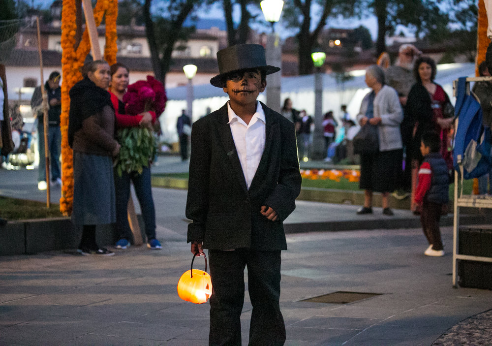 10/31/17 - 7:00pm - A boy dressed for the All Hallows Eve festivities explores the town square collecting candy and toys from local vendors.
