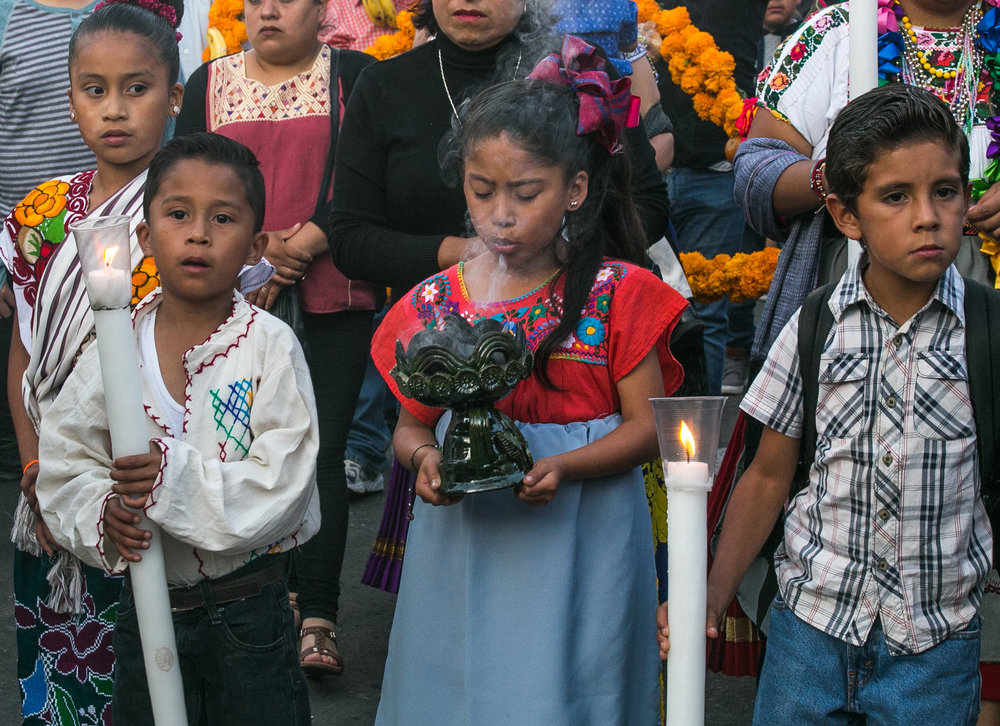 11/1/17 - Children walking with their family to the cemetery hold candles and copal (traditional incense).