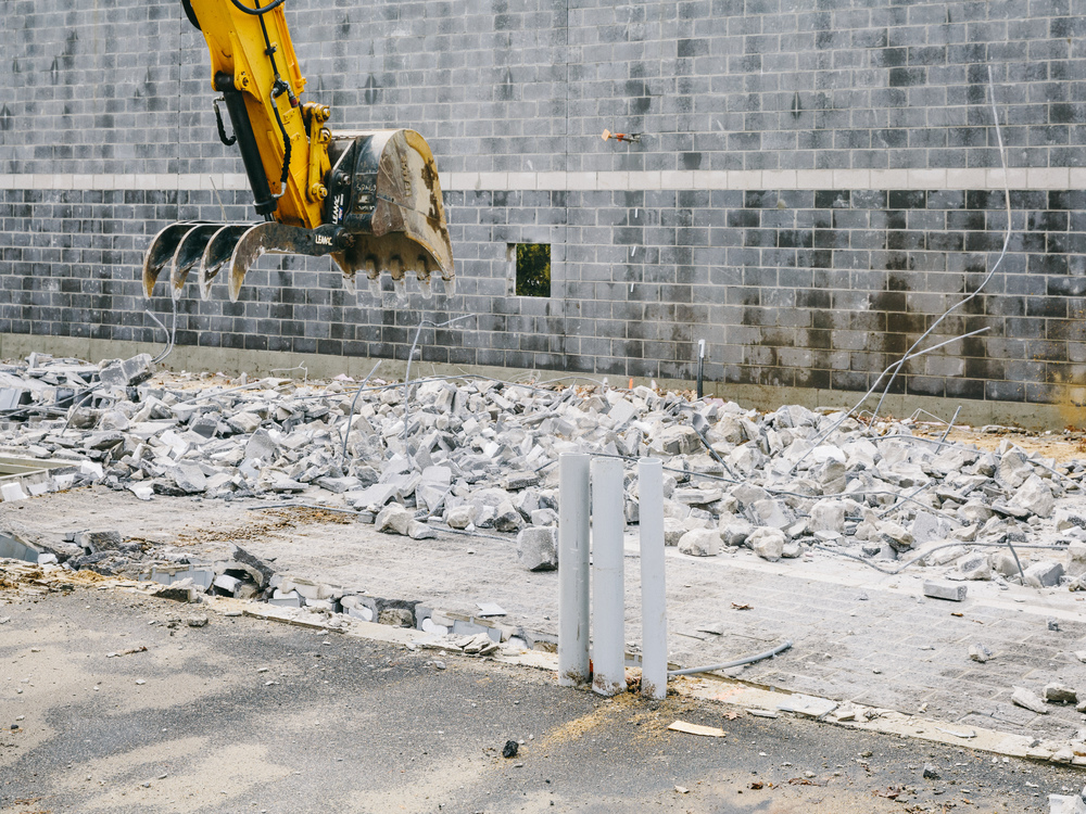 Demolition of New Construction, Used Car Superstore, Nashua, New Hampshire, 2014.