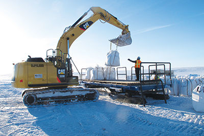 Loading sample bags for transport to Iqaluit.jpg