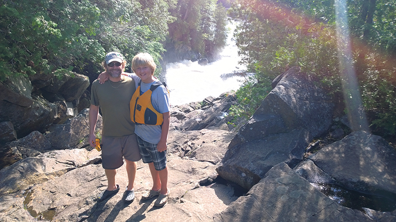 Dan Kraus (here with son Logan at Ragged Falls, Ontario) believes natural capital valuation can help Canadians better understand the benefits of conservation. NCC
