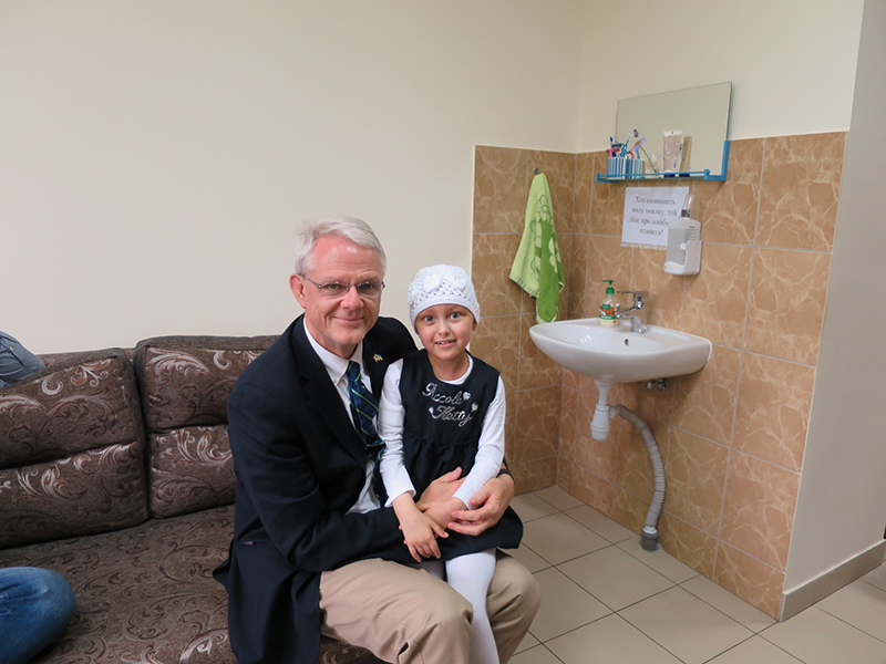 Dr. James Rutka with a young patient in Ukraine. supplied