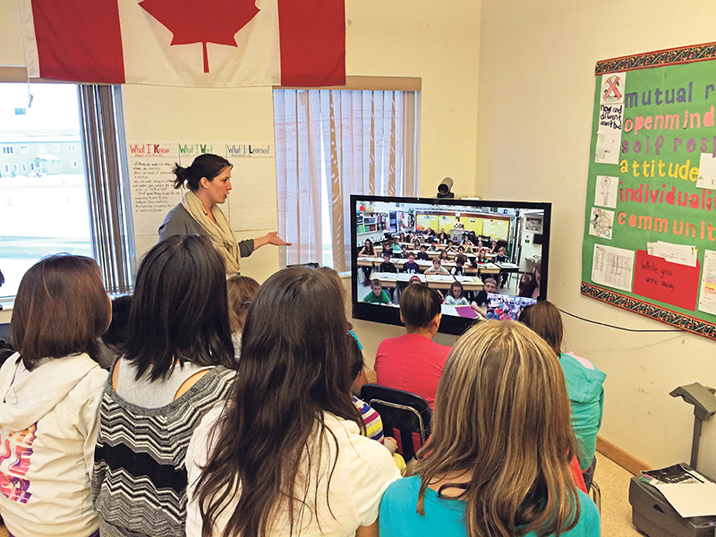 Top: Public health nurses Fiona Fryer and Sandy Rennick of the Grey Bruce Health Unit conduct a school immunization exercise using the Panorama Immunization System. Bottom: The Grade 6 class at Aqsarniit Middle School in Iqaluit meets with a Grade 6 class at Busby Elementary School in Busby, Alberta. MOHLTC; Cisco Canada