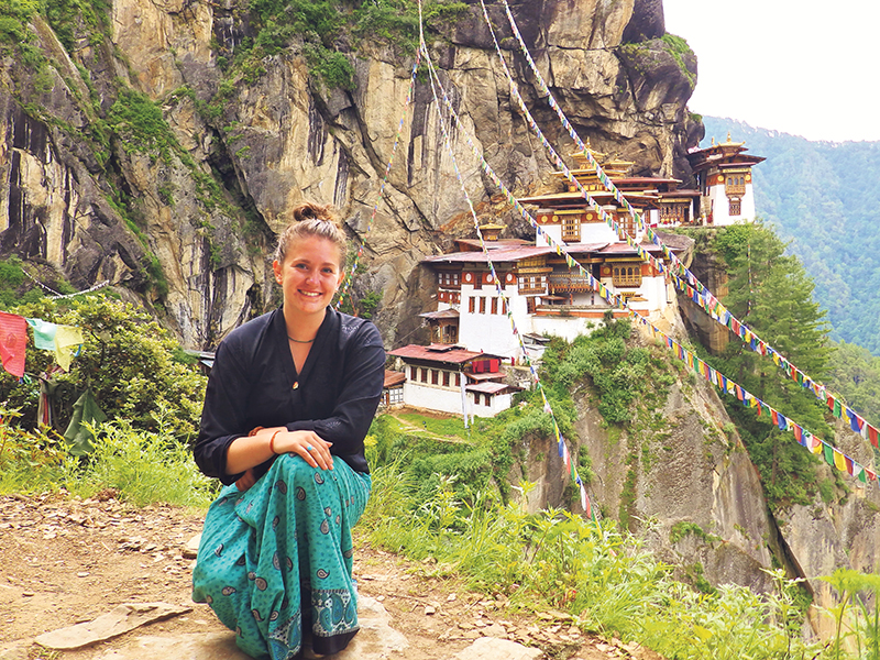 Sara Taaffe in front of the iconic Buddhist temple complex, Paro Taktsang, in Bhutan, July 2014. supplied