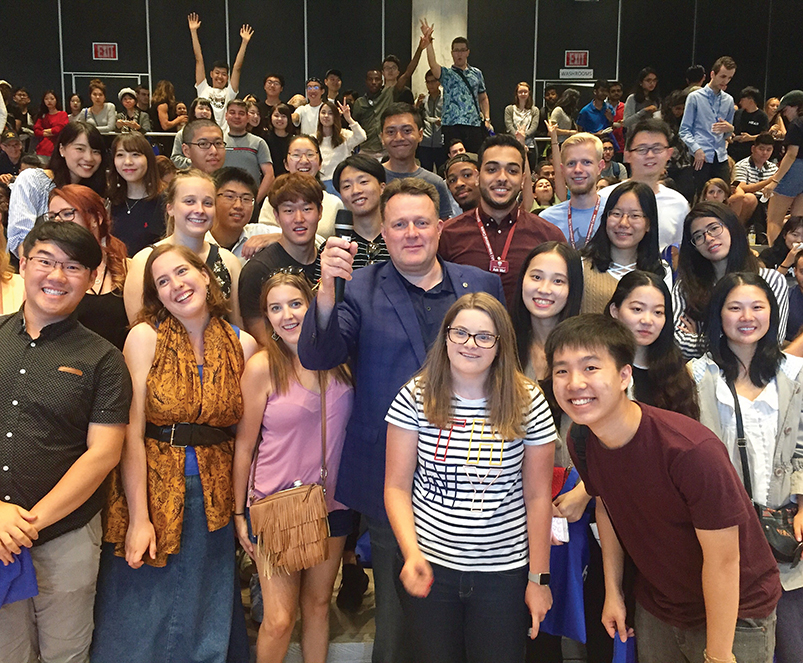Halifax Mayor Mike Savage stands alongside first-year international students to convey the message that they are welcome and appreciated. JESSICA BRADLEY