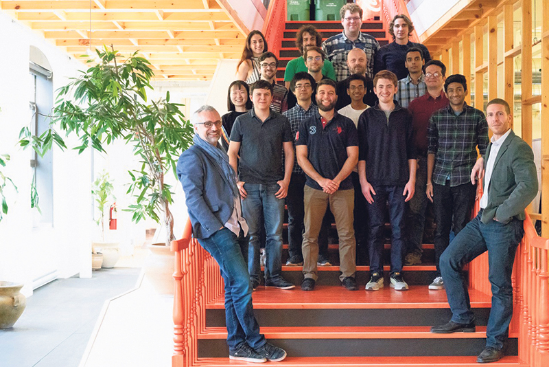 Yves Jacquier (left) and Derek Nowrouzezahrai (right) pictured with members of the McGill Graphics and Imaging Lab on location at Ubisoft, Montreal. Olivier Blouin