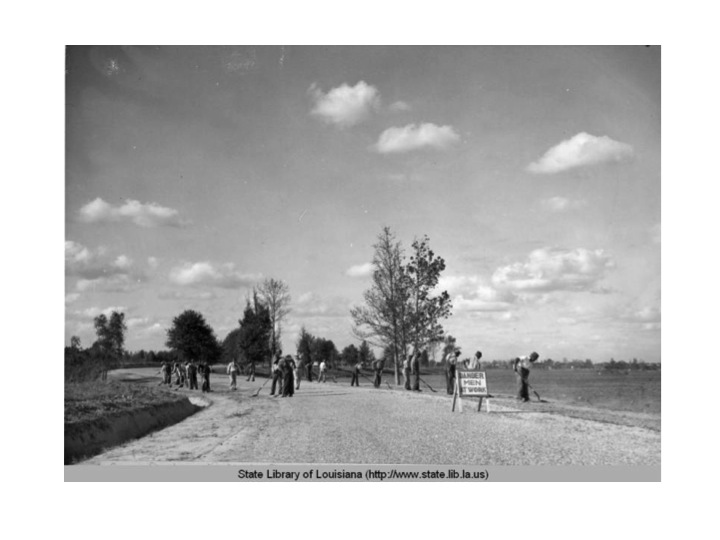 Works Progress Administration employees put finishing touches on a lakeside road. At its peak, 900 employees worked on the lakes and other LSU-area projects.