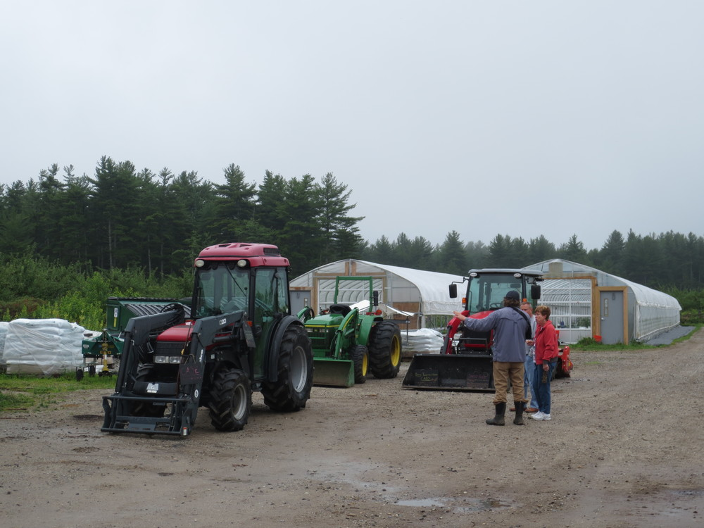 A small group learning about the tractors and implements used at Pietree.